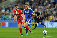 Blackburn's Craig Conway plays the ball while being tracked by Cardiff's Aron Gunnarsson. EFL Skybet championship match, Cardiff city v Blackburn Rovers at the Cardiff city stadium in Cardiff, South Wales on Wednesday 17th August 2016.<br /> pic by Carl Robertson, Andrew Orchard sports photography.