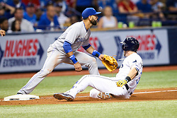 August 22, 2017 - St. Petersburg, Florida, U.S. - WILL VRAGOVIC       Times.Tampa Bay Rays third baseman Evan Longoria (3) safe at third after his double and the error by Toronto Blue Jays left fielder Ezequiel Carrera (3) in the fifth inning of the game between the Toronto Blue Jays and the Tampa Bay Rays at Tropicana Field in St. Petersburg, Fla. on Tuesday, Aug. 22, 2017. (Credit Image: © Will Vragovic/Tampa Bay Times via ZUMA Wire)