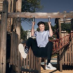 Felix Radu, a Belgian comedian and author, posing in a playground. Paris, France. June 1st, 2021.<br /> Felix Radu, comedien et auteur belge, prenant la pose au milieu des jeux d'enfants dans un parc. Paris, France. June 1st, 2021.