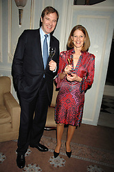 MR & MRS ROBERT BROOKS at a dinner to celebrate the launch of the Dom Ruinart 1998 vinatage champage at Claridge's, Brook Street, London W1 on 23rd April 2008.<br />