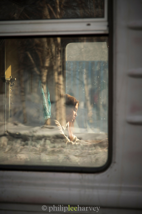 A passenger sat on a train at Tynda station. BAM (Baikal-Amur Mainline).Tynda, Siberia, Russia