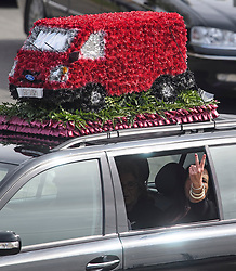 © Licensed to London News Pictures. 03/05/2018. Swanley, UK. A woman gestures form a car window as The funeral procession of burglar Henry Vincent leaves Swanley to head to a service in St Mary Cray, Bromley, London. Henry Vincent, who is part of a traveller community in the south east London, died during an attempted burglary of the home of pensioner Richard Osborn-Brook in Hither Green. Photo credit: Ben Cawthra/LNP