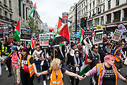 Pro-Palestinian activists join thousands of people attending a United Against The Tories national demonstration organised by the Peoples Assembly Against Austerity in protest against the policies of Prime Minister Boris Johnsons Conservative government on 26th June 2021 in London, United Kingdom. The demonstration contained blocs from organisations and groups including Palestine Solidarity Campaign, Stand Up To Racism, Stop The War Coalition, Extinction Rebellion, Kill The Bill and Black Lives Matter as well as from trade unions Unite and the CWU.