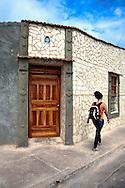 Woman and house in Gibara,Holguin,Cuba.