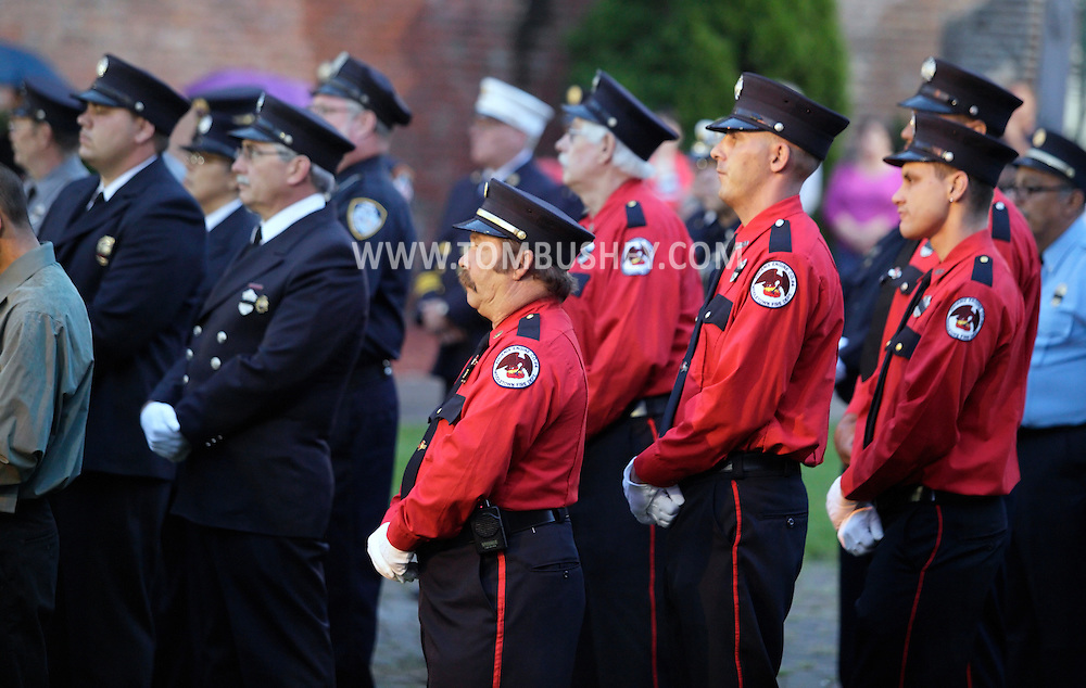 Middletown, New York - Firefighters in dress uniforms listen to a speaker during the Middletown Fire Department 9/11 Memorial Service at Festival Square on Sept. 11, 2011.