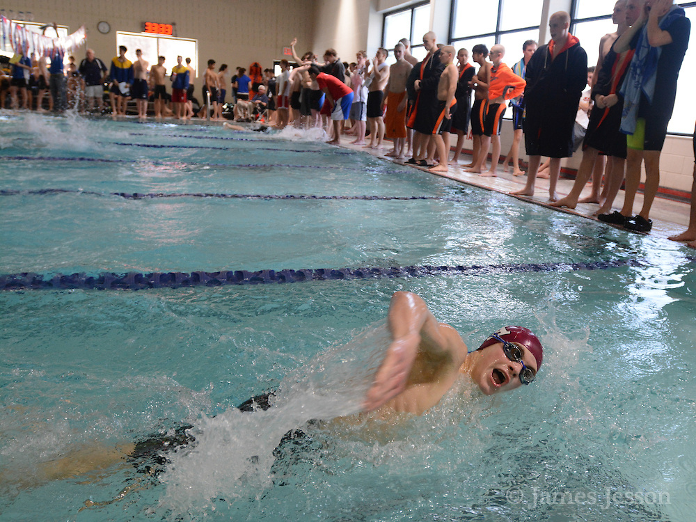 Westford Academy freshman Adam Mullin pulls into a flip turn off the wall during the DCL meet at Atkinson Pool in Sudbury, Jan. 31, 2015.   (Wicked Local Photo/James Jesson)