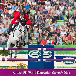 Daniel Deusser, (GER), Cornet D Amour - World Champions, - Second Round Team Competition - Alltech FEI World Equestrian Games™ 2014 - Normandy, France.<br /> © Hippo Foto Team - Leanjo De Koster<br /> 25/06/14