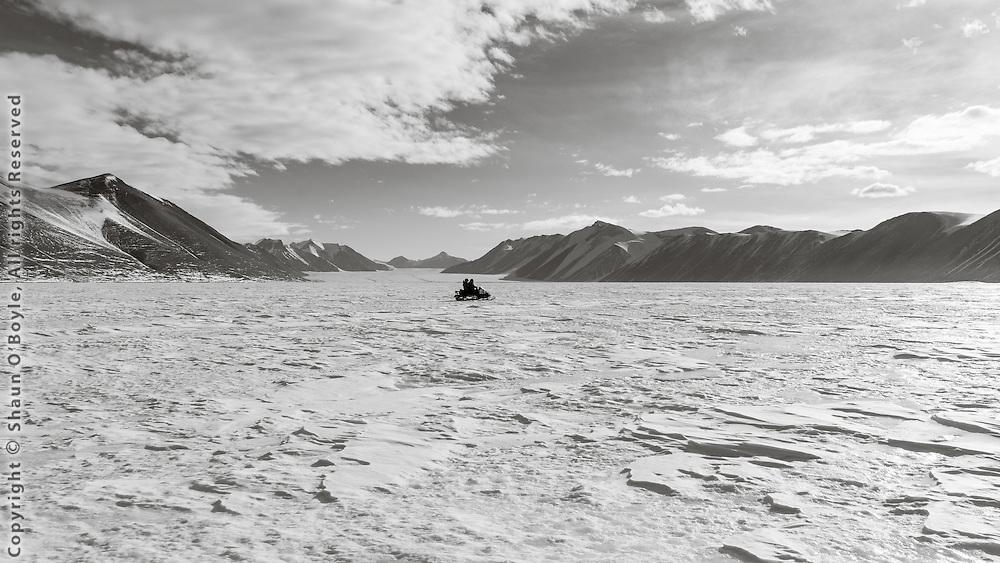 Snow mobiling across New Harbor at the Ferrar Glacier