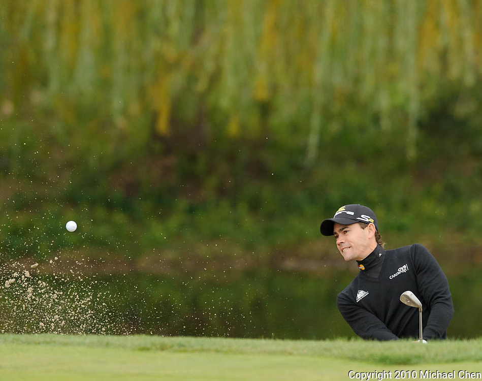 Camilo Villegas hits out of the bunker on hole 3 during Round 3 of the 2010 Chevron World Challenge at the Sherwood Country Club in Thousand Oaks, Calif., on Saturday, Dec. 4, 2010.
