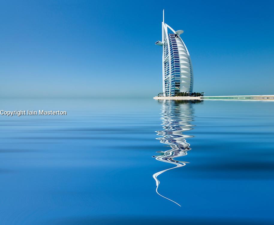 Luxury Burj al Arab Hotel with reflection  in Dubai United Arab Emirates UAE