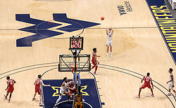 Feb 13, 2021; Morgantown, West Virginia, USA; West Virginia Mountaineers guard Sean McNeil (22) shoots a three pointer during the second half against the Oklahoma Sooners at WVU Coliseum. Mandatory Credit: Ben Queen-USA TODAY Sports