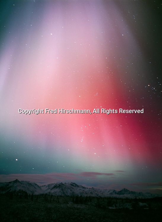 Aurora in pastel shades of pink, purple and green above the Chugach Mountains and Matanuska River Valley southwest of Tahneta Pass, geomagnetic storm on morning of November 20, 2003, Alaska.
