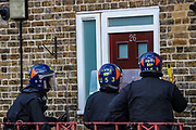 Meanwhile, police are breaking the door of a suspected fugitive another officer is standing by with a taser fearing that the man who is alleged to have assaulted members of the public and emergency worker in south London on  Tuesday, Aug 18, 2020, would come out and attack them before he surrenders. <br /> Members of the MET police crew stormed into his barricaded doorstep after Martin wouldn't respond to their multiple calls to surrender as he was declared that he was going to be arrested.<br /> After breaking the door police stumbled into a barricade made of a ladder, washing machine, several chairs and other wood and plastic items. After forcing themselves into his apartment, police couldn't find him. The search is on-going. (VXP Photo/ Vudi Xhymshiti) would come out and attack them before he surrenders. <br /> Members of the MET police crew stormed into his barricaded doorstep after Martin wouldn't respond to their multiple calls to surrender as he was declared that he was going to be arrested.<br /> After breaking the door police stumbled into a barricade made of a ladder, washing machine, several chairs and other wood and plastic items. After forcing themselves into his apartment, police couldn't find him. The search is on-going. (VXP Photo/ Vudi Xhymshiti)