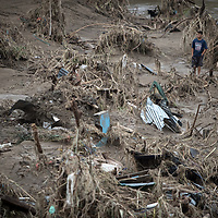 Devastation caused by hurricanes Eta and Iota in San Pedro Sula, Honduras. A man walks through the vestiges of an area that was covered in housing in Chamelecón.