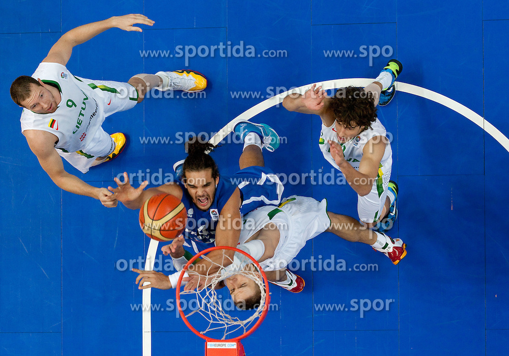 Robertas Javtokas of Lithuania vs Joakim Noah of France during basketball game between National basketball teams of Lithuania and France at FIBA Europe Eurobasket Lithuania 2011, on September 9, 2011, in Siemens Arena,  Vilnius, Lithuania. France defeated Lithuania 73-67.  (Photo by Vid Ponikvar / Sportida)