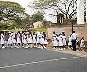 School children in uniform walking in a street in the historic town of Galle, Sri Lanka, Asia