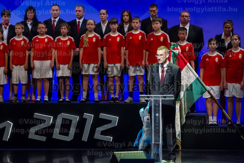 Penthatlon world champhion Adam Marosi (front R) delivers his speech during a swearing in ceremony of the Hungarian Olympic Team that will travel to London in Budapest, Hungary on June 22, 2012. ATTILA VOLGYI