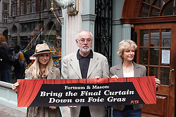 © licensed to London News Pictures. LONDON, UK  05/05/2011. Actors Peter Egan (C), Carley Stenson (L) and Jenny Seagrove (R) protest on behalf of PETA outside Fortum & Mason in Piccadilly. PETA wants the store to stop selling Foie Gras claiming the methods used in its production are cruel. Please see special instructions for usage rates. Photo credit should read CLIFF HIDE/LNP