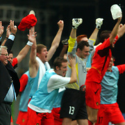 Belgium Coach Robert Waseige (left) celebrates victory over Russia and their passage to the second round and a tie against Brazil