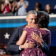 President Barak Obama and Michelle Obama embrace after she introduced her husband on the final night of the 2012 DNC in Charlotte, NC.