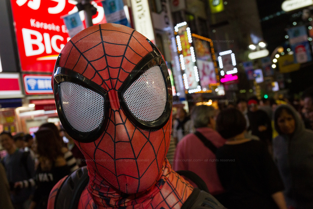 A man wears a Spiderman costume during the Halloween celebrations Shibuya, Tokyo, Japan. Saturday October 27th 2018. The celebrations marking this event have grown in popularity in Japan recently. Enjoyed mostly by young adults who like to dress up, drink , dance and misbehave in parts of Tokyo like Shibuya and Roppongi. There has been a push back from Japanese society and the police to try to limit the bad behaviour.