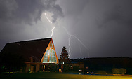 Middletown, New York - Lightning streaks across the sky behind the main chapel at the National Shrine of Our Lady of Mount Carmel during a thunderstorm on the night of Aug. 1, 2011.