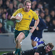 Wallaby captain Rocky Elsom scores a try for Australia beating All Black Andrew Hore during the New Zealand V Australia Tri-Nations, Bledisloe Cup match at Eden Park, Auckland. New Zealand. 6th August 2011. Photo Tim Clayton