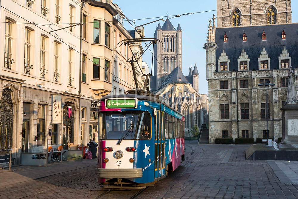 De Lijn tram travels along route 4 to Zwinjaardebrug in central Ghent, Belgium.