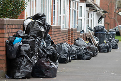 © Licensed to London News Pictures. 15/01/2019. Birmingham, West Midlands UK. Pictured, rubbish outside houses in Newland Road, Small Heath. The Birmingham Bin Strike enters a third week and large piles of uncollected rubbish are starting to appear on the streets of inner City Birmingham. The Refuse collectors took strike action in 2018 and forced a change of Council Leadership. Residents have complained of seeing rats and white worms outside their houses. Photo credit: Dave Warren/LNP