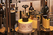 The winery, the labelling machine - Chateau Baron Pichon Longueville, Pauillac, Medoc, Bordeaux, Grand Cru