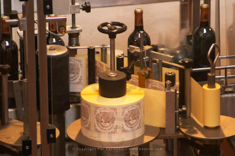 The winery, the labelling machine - Chateau Baron Pichon Longueville, Pauillac, Medoc, Bordeaux, Grand Cru