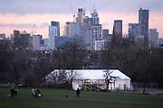 With the backdrop of construction at Nine Elms, the temporary facility serving as an asymptomatic COVID-19 testing centre is located in Brockwell Park in Lambeth, during the third pandemic lockdown, on 21st January 2021, in London, England. Government ministers are to discuss proposals to pay anyone in England who tests positive for Covid-19 £500 to self-isolate. Many workers are currently strugling financially because low paid workers cannot afford to self-isolate.