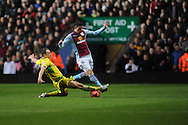 Sheffield Utd's Anthony McMahon battles with Aston Villa's Aleksander Tonev during the FA Cup with Budweiser, 3rd round, Aston Villa v Sheffield Utd match  at Villa Park in Birmingham, England on Saturday 4th Jan 2014.<br /> pic by Jeff Thomas, Andrew Orchard sports photography.