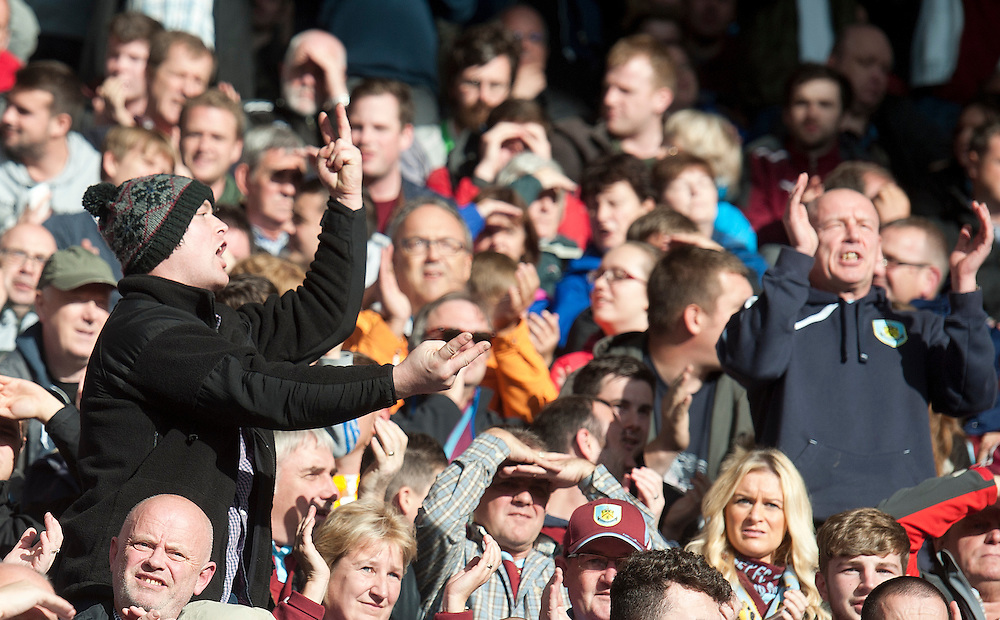 Burnley fans watch their team earn a point with a goal in the sixth minute of added time<br /> <br /> Photographer Stephen White/CameraSport<br /> <br /> Football - Barclays Premiership - Leicester City v Burnley - Saturday 04th October 2014 - King Power Stadium - Leicester<br /> <br /> © CameraSport - 43 Linden Ave. Countesthorpe. Leicester. England. LE8 5PG - Tel: +44 (0) 116 277 4147 - admin@camerasport.com - www.camerasport.com