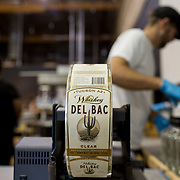 Tucson, AZ -- 09/28/2017<br /> <br /> Hamilton Distillers staff bottles Whiskey Del Bac Clear with the help of volunteers. All volunteers sign up online, work a 4-5 hour shift, receive lunch and take home a bottle of whiskey.<br /> <br /> Hamilton Distillers, makers of Whiskey Del Bac, is the first craft distillery in Southern Arizona since prohibition. The company produces three distinct single malt whiskeys, including Whiskey Del Bac Dorado which is malted over mesquite.<br /> <br /> The distillery offers tours and tastings on Saturdays at 3 p.m. <br /> <br /> Photography by Jill Richards
