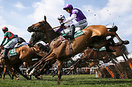 Twisting in the air but over safely is Coolanly ridden by Paddy Brennan in the 1:45pm The Gaskells Handicap Hurdle (Grade 3) during the Grand National Meeting at Aintree, Liverpool, United Kingdom on 6 April 2019.