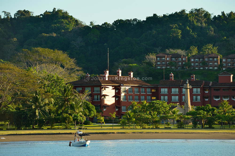 A recreational fishing boat at anchor in front of the upscale resort of Herradura, Costa Rica.
