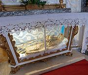 Interior of historic Roman Catholic church Igreja de Santa Maria da Devesa,  Castelo de Vide, Alto Alentejo, Portugal, southern Europe - effigy of Blessed Virgin Mary inside glass display cabinet
