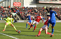 Leicester City's Demarai Gray sees his shot stopped by Fleetwood Towns' Chris Neal