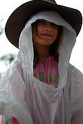 Child (6 years old) wearing Akubra bush-hat over plastic raincoat. Sydney, Australia