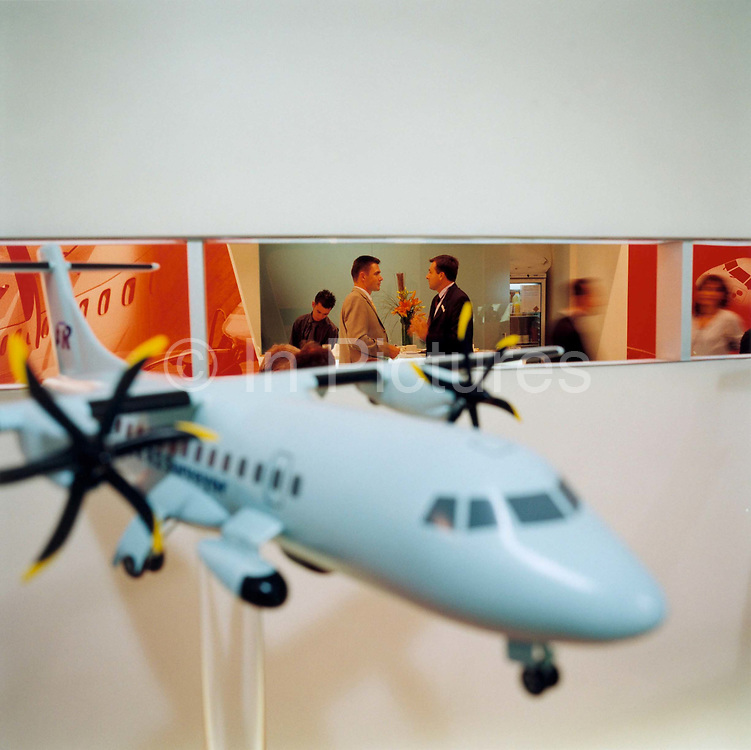 Business deals being sealed at the ATR aviation stand during the bi-annual aerospace industry expo at the Farnborough airshow in southern England. ATR (Aerei da Trasporto Regionale or Avions de transport régional) is a French-Italian aircraft manufacturer headquartered on the grounds of Toulouse Blagnac International Airport in Blagnac, France. It was formed in 1981 by Aérospatiale of France (now EADS) and Aeritalia (now Alenia Aermacchi) of Italy. Its primary products are the ATR 42 and ATR 72 aircraft.