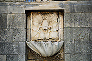 Frog motif carved in stone. Sea gate, Korcula old town, island of Korcula, Croatia.