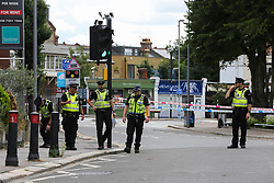 © Licensed to London News Pictures. 18/08/2020. London, UK. British Transport Police search team carrying out the search on Larkshall Road in Chingford, East London after a man was stab near Highams Park railway station. Police were called shortly before 02:30hrs on Tuesday, 18 August following reports of a man with stab injuries. Prior to the arrival of London Ambulance Service, officers carried out first aid on the 18-year-old- man. He was taken to an east London hospital and his injuries are currently believed to be life threatening. The man is thought to have sustained his injuries during a fight with three other men near to the railway crossing. Photo credit: Dinendra Haria/LNP