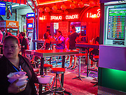 20 SEPTEMBER 2013 - BANGKOK, THAILAND:  A foreign exchange booth next to a go-go bar on Soi Cowboy in Bangkok. Soi Cowboy is one of the notorious Entertainment Districts in Bangkok. Entertainment District has emerged as euphemism for red light district. Prostitution is officially illegal in Thailand but it is widely condoned. For western men, Soi Cowboy, along with Soi Nana and Patpong are among the most well known entertainment districts in Bangkok.      PHOTO BY JACK KURTZ