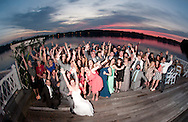 Newlyweds Andy Bayley and Kate Comerford (foreground) with their bridal party, family and guests during their wedding reception at The Canebreak Clubhouse in Hattiesburg, MS on Saturday, March 14, 2015.  © Chet Gordon • Photographer
