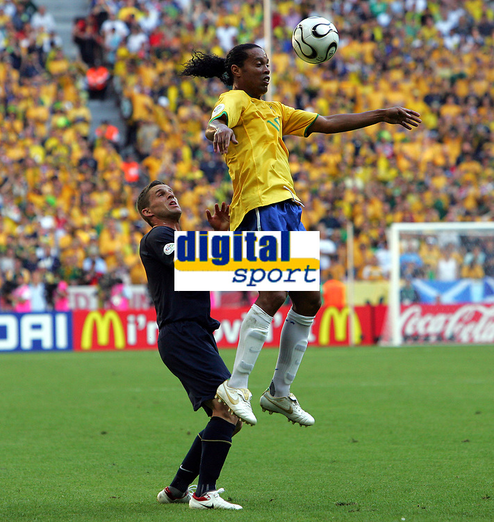 "Ronaldinho is chaalenged by Australia""s Jason Culina<br />