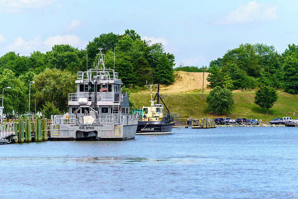 Chesapeake City, MD, USA - June 28. 2020: The H.R. Spies, a U.S. Army Corps of Engineers boat, at dock on the Chesapeake and Delaware Canal.