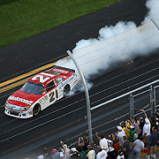 Trevor Bayne driving the Motorcraft/Quick Lane Ford celebrates after winning the Daytona 500 Sprint Cup race at Daytona International Speedway on February 20, 2011 in Daytona Beach, Florida. (AP Photo/Alex Menendez)