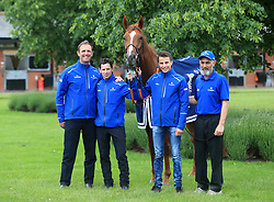 Trainer Charlie Appleton (left), day to day jockey Brett Doyle (centre left), winning jockey William Buick (centre right) and groom Saeed pose with Masar during the homecoming event at Moulton Paddocks, Newmarket.