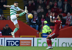 Celtic's Emilio Izaguirre and Aberdeen's Shay Logan battle for the ball during the Scottish Premiership match at Pittodrie Stadium, Aberdeen.